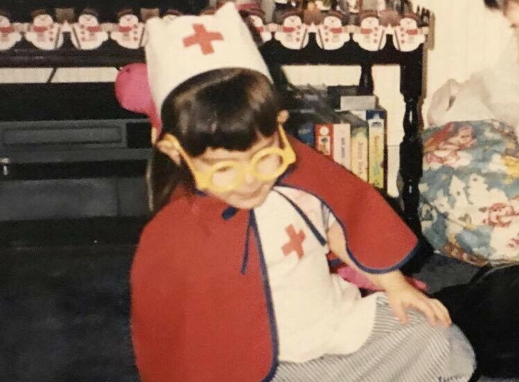 child dressed as a nurse