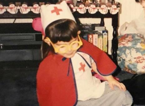child dressed as a nurse